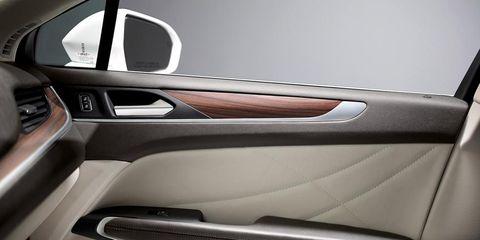 Motor vehicle, Automotive design, Vehicle door, Personal luxury car, Fixture, Luxury vehicle, Steering wheel, Steering part, Car seat, Automotive door part,