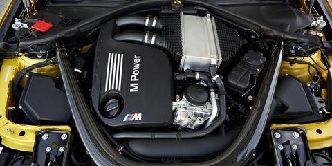 Engine, Automotive exterior, Motorcycle accessories, Automotive engine part, Personal luxury car, Carbon, Luxury vehicle, Kit car, Motorcycle, Automotive super charger part,