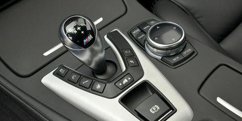 Automotive design, Luxury vehicle, Personal luxury car, Gear shift, Mercedes-benz, Center console, Sports car, Silver, Carbon, Symbol,