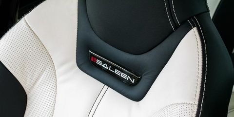 Car seat, Luxury vehicle, Leather, Carbon, Silver, Walking shoe,