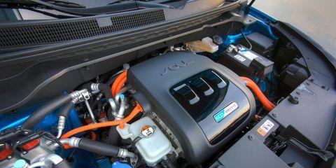Engine, Electric blue, Machine, Automotive engine part, Luxury vehicle, Fuel line, Personal luxury car, Engineering, Kit car, Hood,