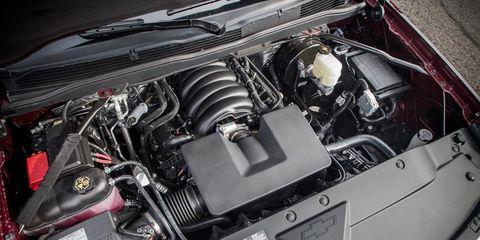 Engine, Automotive engine part, Automotive air manifold, Personal luxury car, Automotive super charger part, Hood, Fuel line, Kit car, Screw, Automotive fuel system,