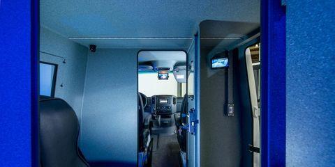 Blue, Transport, Public transport, Fixture, Azure, Teal, Electric blue, Vehicle door, Passenger, Machine,