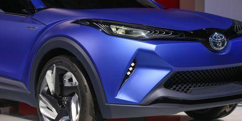 Motor vehicle, Tire, Automotive design, Blue, Daytime, Vehicle, Automotive exterior, Headlamp, Automotive wheel system, Land vehicle,
