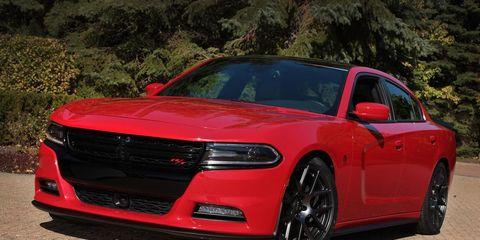Tire, Wheel, Automotive design, Vehicle, Land vehicle, Hood, Automotive lighting, Car, Red, Grille,