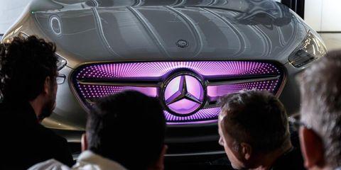 Automotive design, Automotive exterior, Grille, Car, Technology, Logo, Magenta, Automotive lighting, Light, Hood,