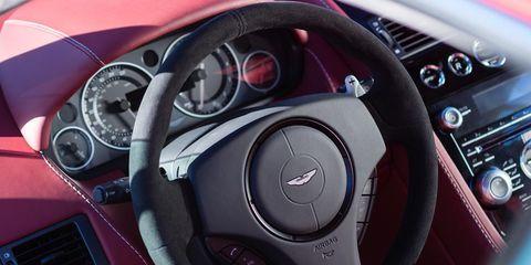 Motor vehicle, Mode of transport, Automotive design, Steering wheel, Steering part, Vehicle, Car, Red, Speedometer, Gauge,