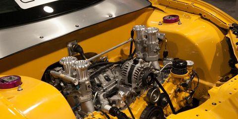 Motor vehicle, Yellow, Engine, Automotive engine part, Automotive fuel system, Automotive super charger part, Nut, Automotive air manifold, Fuel line, Classic,