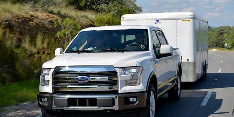 Motor vehicle, Vehicle, Land vehicle, Automotive design, Automotive tire, Transport, Rim, Automotive exterior, Grille, Road surface,