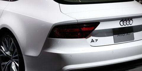 Automotive design, Vehicle, Automotive tail & brake light, Automotive exterior, Automotive lighting, Car, White, Rim, Vehicle registration plate, Fender,