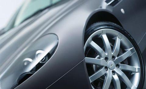 Automotive design, Alloy wheel, Rim, Automotive wheel system, Spoke, Automotive exterior, Personal luxury car, Automotive tire, Luxury vehicle, Hubcap,