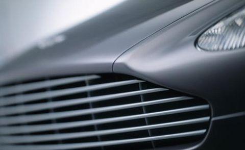 Automotive design, Grille, Automotive exterior, Light, Grey, Hood, Headlamp, Silver, Trademark, Steel,