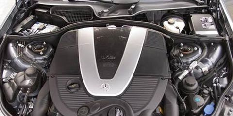 Engine, Motorcycle accessories, Automotive engine part, Personal luxury car, Metal, Motorcycle, Automotive fuel system, Carbon, Luxury vehicle, Automotive air manifold,