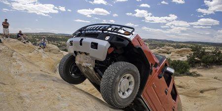 Tire, Wheel, Automotive tire, Automotive design, Automotive exterior, Natural environment, Vehicle, Rim, Landscape, Automotive wheel system,
