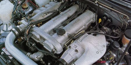 Engine, Automotive engine part, Automotive air manifold, Machine, Metal, Automotive super charger part, Cylinder, Automotive fuel system, Fuel line, Nut,