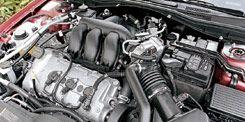 Motor vehicle, Engine, Automotive engine part, Automotive fuel system, Automotive air manifold, Machine, Metal, Automotive super charger part, Nut, Fuel line,