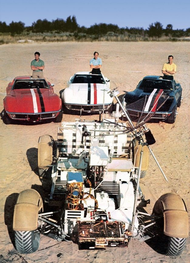 jim irwin, al worden, and dave scott pose with their corvettes and a lunar rover