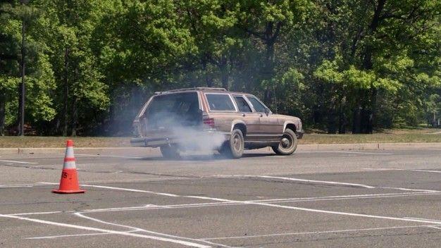 old station wagon blowing smoke