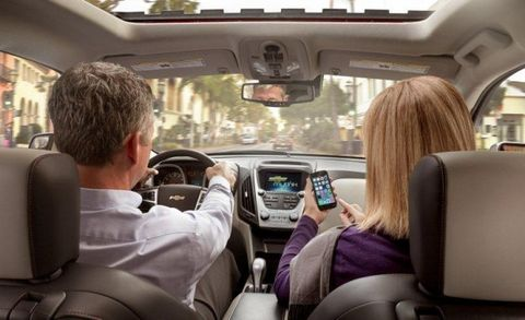 couple pairing phone with car connectivity