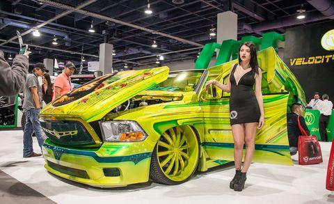Automotive design, Grille, Hood, Dress, High heels, Bumper, Logo, Auto show, Exhibition, Headlamp,