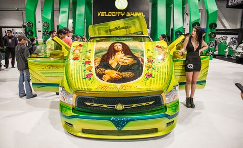 Motor vehicle, Green, Automotive design, Logo, Exhibition, Grille, Bumper, Hood, Auto show, Advertising,