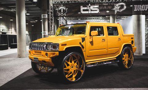 Tire, Motor vehicle, Wheel, Automotive tire, Automotive design, Automotive exterior, Yellow, Vehicle, Transport, Rim,