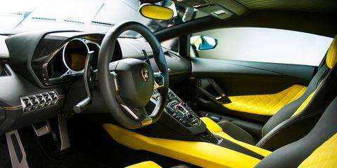 Motor vehicle, Steering part, Mode of transport, Automotive design, Yellow, Vehicle, Steering wheel, Transport, Car seat, Vehicle door,
