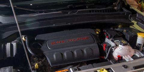 Engine, Automotive exterior, Automotive engine part, Automotive air manifold, Hood, Fuel line, Trunk, Kit car, Automotive super charger part, Screw,