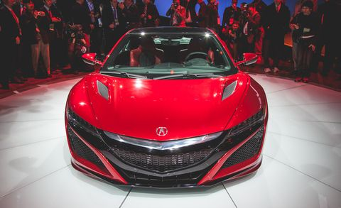 Automotive design, Mode of transport, Vehicle, Event, Land vehicle, Car, Grille, Red, Auto show, Personal luxury car,