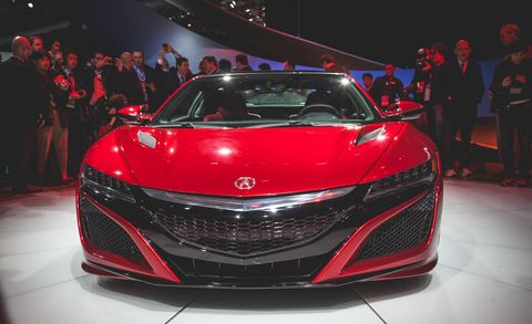 Mode of transport, Automotive design, Vehicle, Land vehicle, Event, Car, Red, Grille, Personal luxury car, Auto show,