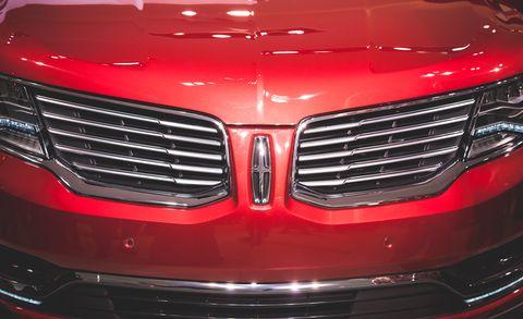Automotive design, Event, Vehicle, Grille, Automotive exterior, Red, Car, Concept car, Personal luxury car, Carmine,