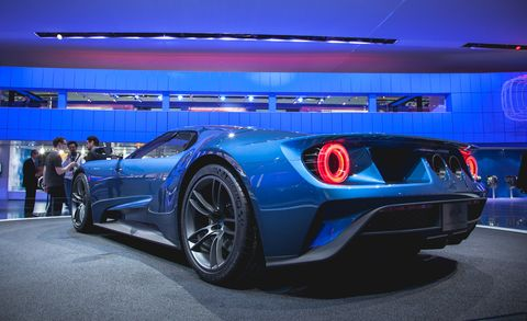 Wheel, Tire, Mode of transport, Automotive design, Blue, Vehicle, Performance car, Supercar, Automotive lighting, Rim,