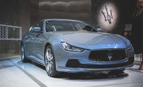 Automotive design, Vehicle, Event, Land vehicle, Car, Personal luxury car, Headlamp, Rim, Performance car, Mid-size car,