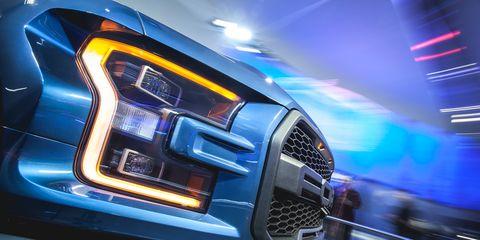 Motor vehicle, Automotive design, Automotive lighting, Grille, Headlamp, Car, Bumper, Electric blue, Luxury vehicle, Logo,