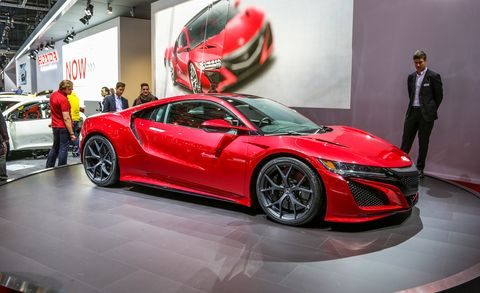 Tire, Wheel, Automotive design, Land vehicle, Vehicle, Event, Car, Auto show, Red, Exhibition,