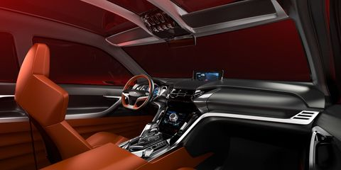 Motor vehicle, Mode of transport, Automotive design, Steering part, Steering wheel, Vehicle door, Center console, Personal luxury car, Fixture, Luxury vehicle,