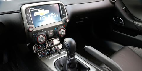 Motor vehicle, Mode of transport, Automotive design, Electronic device, Center console, Technology, Display device, Steering part, Luxury vehicle, Gear shift,