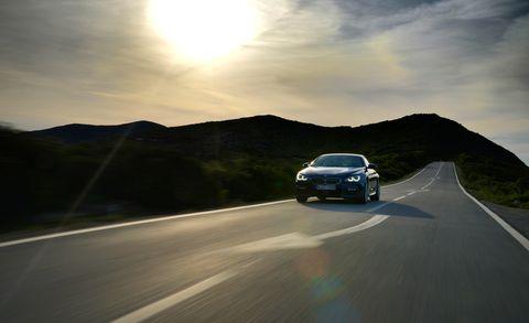 Motor vehicle, Road, Automotive design, Automotive mirror, Road surface, Automotive lighting, Infrastructure, Asphalt, Automotive exterior, Highland,