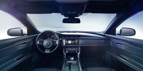 Motor vehicle, Mode of transport, Automotive design, Steering part, Steering wheel, Center console, Automotive mirror, Car, Vehicle audio, Glass,