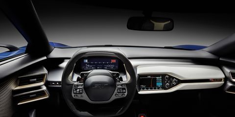 Motor vehicle, Automotive design, Product, Steering wheel, Steering part, Center console, Automotive mirror, Vehicle audio, Technology, Luxury vehicle,