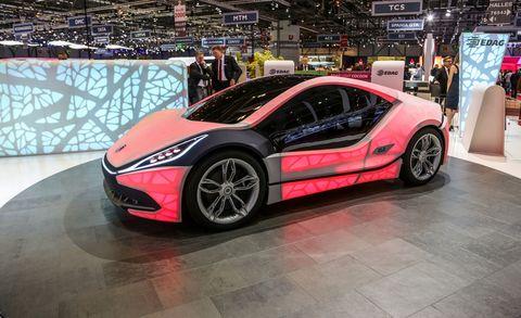 Wheel, Tire, Automotive design, Vehicle, Land vehicle, Event, Car, Auto show, Exhibition, Sports car,