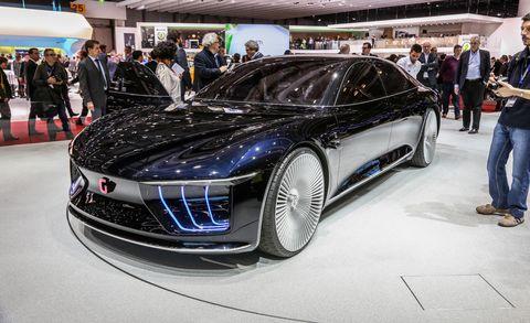 Automotive design, Vehicle, Land vehicle, Event, Car, Grille, Personal luxury car, Auto show, Exhibition, Luxury vehicle,
