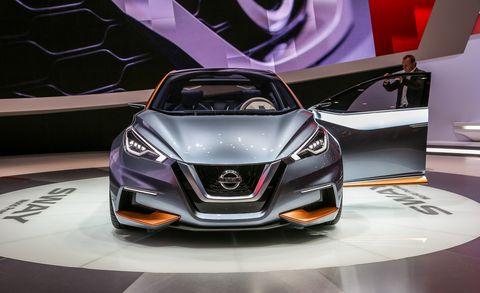Automotive design, Vehicle, Event, Concept car, Car, Automotive lighting, Grille, Personal luxury car, Display device, Logo,