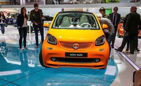 Motor vehicle, Automotive design, Vehicle, Event, Land vehicle, Car, Auto show, Exhibition, Fashion, Orange,