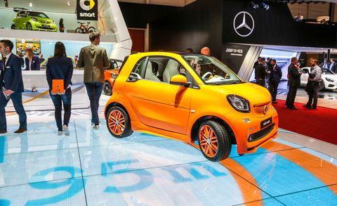 Motor vehicle, Automotive design, Car, Auto show, Exhibition, Hatchback, Alloy wheel, City car, Vehicle door, Automotive wheel system,