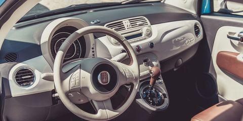 Motor vehicle, Steering part, Mode of transport, Steering wheel, Automotive design, Vehicle, Transport, Automotive mirror, Center console, Speedometer,