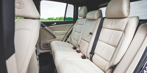 Motor vehicle, Mode of transport, Car seat, Vehicle door, Car seat cover, Head restraint, Seat belt, Automotive window part, Luxury vehicle, Leather,