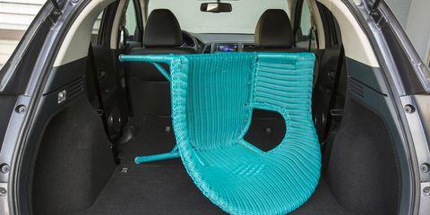 Motor vehicle, Mode of transport, Automotive design, Trunk, Vehicle door, Car seat, Automotive exterior, Teal, Car seat cover, Steering wheel,
