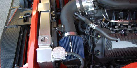 Motor vehicle, Engine, Automotive engine part, Automotive fuel system, Automotive air manifold, Automotive super charger part, Nut, Fuel line, Automotive engine timing part, Kit car,
