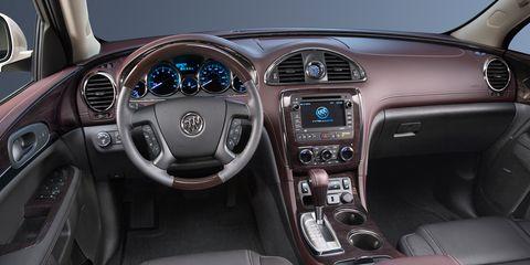 Motor vehicle, Steering part, Steering wheel, Product, Automotive design, Vehicle audio, Center console, White, Technology, Radio,